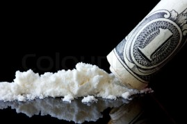 Cocaine and dollar on black background